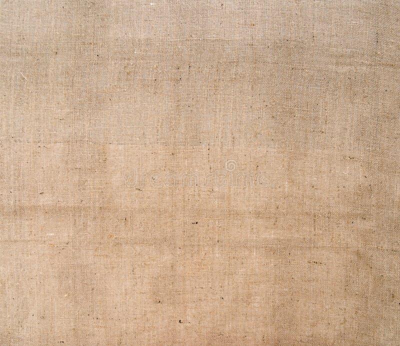 Hessians lantlig bakgrund för säckvävtyg plundra royaltyfria bilder