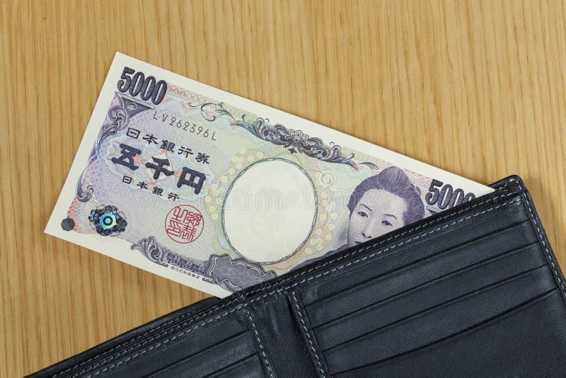 Het één stuk van vijf duizend Japanner int portefeuille dichte omhooggaand royalty-vrije stock foto's