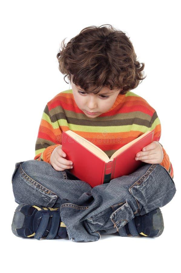 Het aanbiddelijke jongen bestuderen stock fotografie