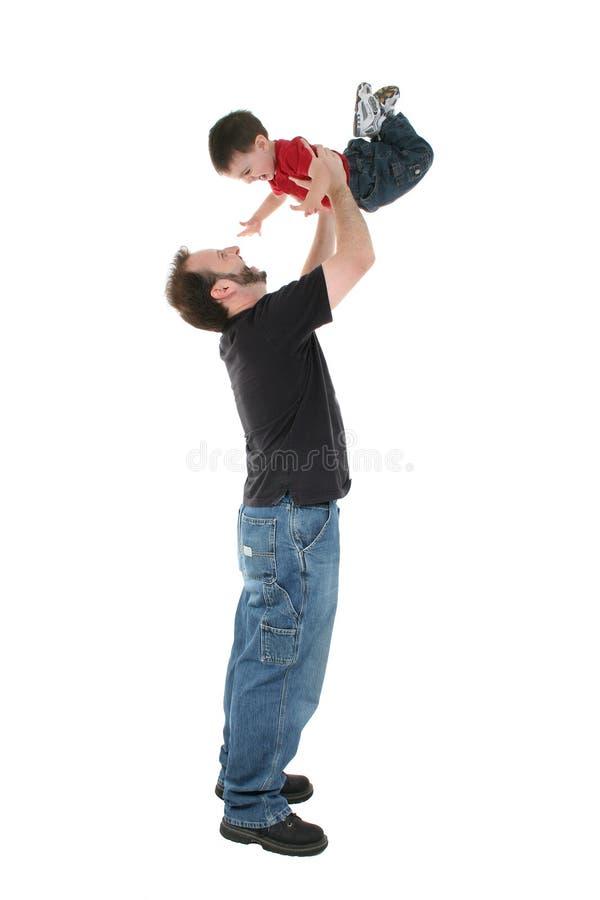 Het aanbiddelijke Ogenblik van de Familie tussen Vader en Zoon stock fotografie