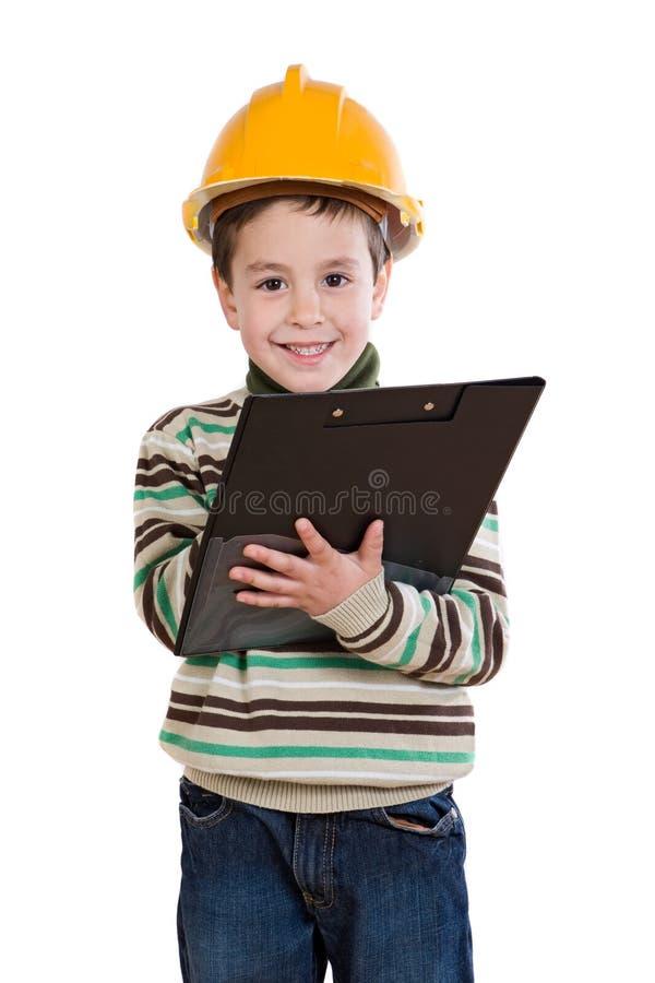Het aanbiddelijke toekomstige ingenieur geïsoleerdl schrijven stock foto
