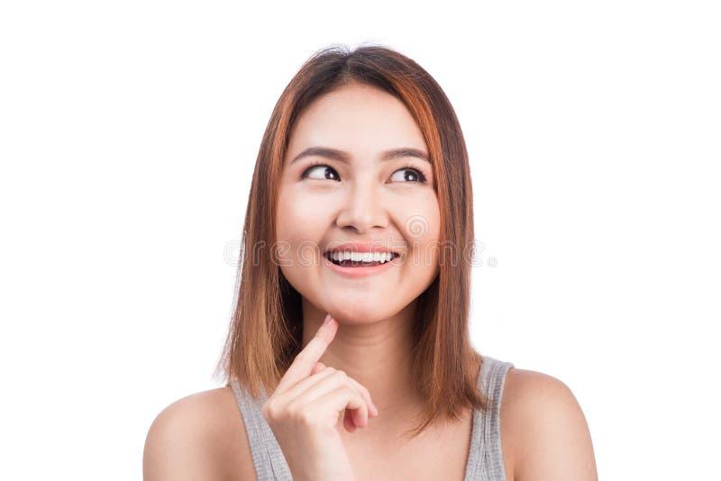 Het aantrekkelijke Aziatische vrouw denken royalty-vrije stock afbeelding