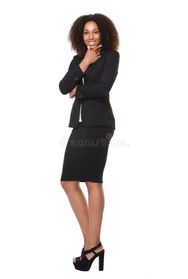 Het aantrekkelijke vrouwelijke bedrijfspersoon glimlachen stock foto's