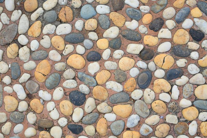 Het abstracte die patroon van muur met kiezelstenen wordt geconstrueerd stock afbeelding
