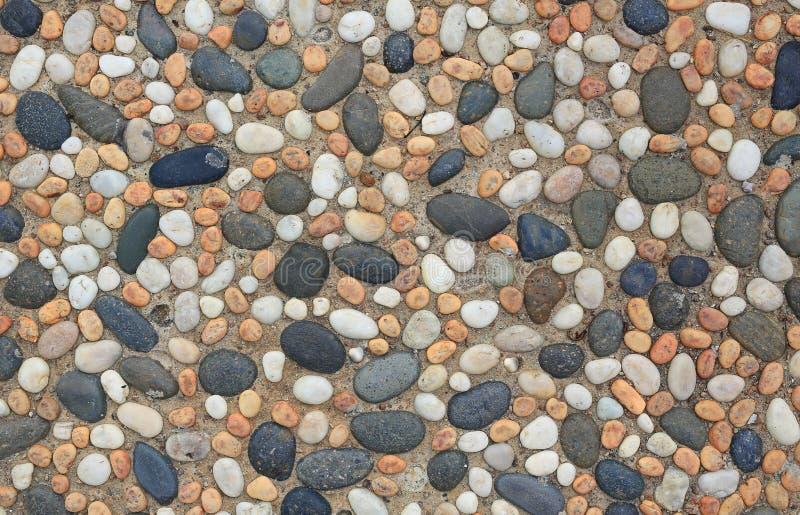 Het abstracte die patroon van muur met kiezelstenen wordt geconstrueerd stock foto