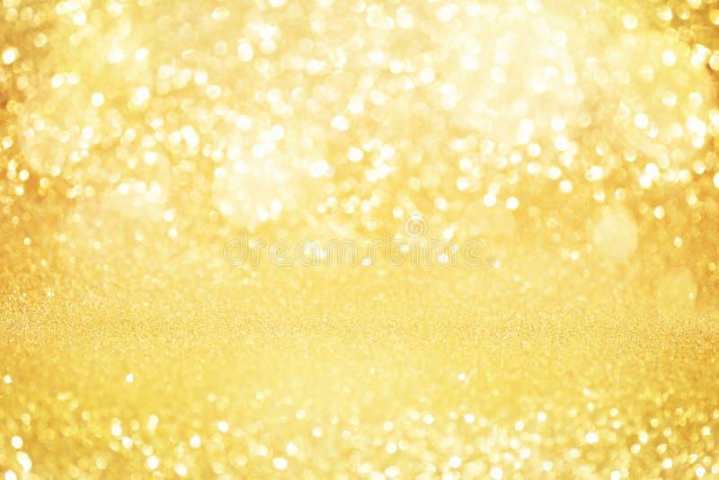 Het abstracte goud schittert bokeh lichten met zachte lichte achtergrond stock foto's