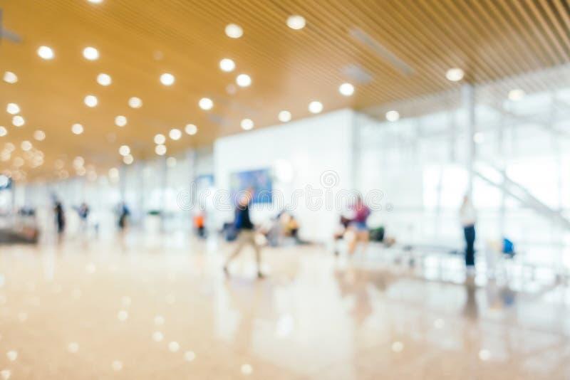 Het abstracte onduidelijke beeld en defocused de terminal van de luchthavenpassagier voor vervoersbinnenland stock afbeeldingen