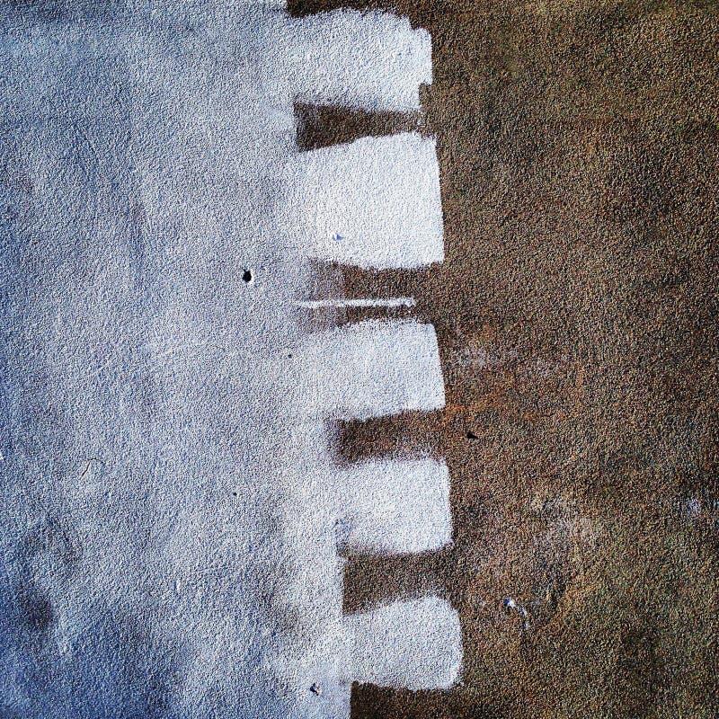 Het abstracte schilderen op een concrete muur royalty-vrije stock fotografie