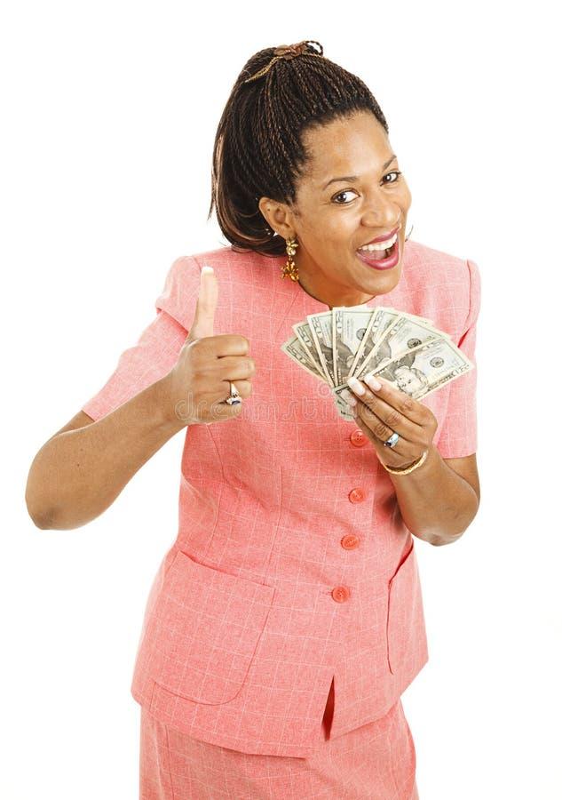 Het Afrikaans-Amerikaanse Contante geld van de Holding van de Vrouw stock fotografie