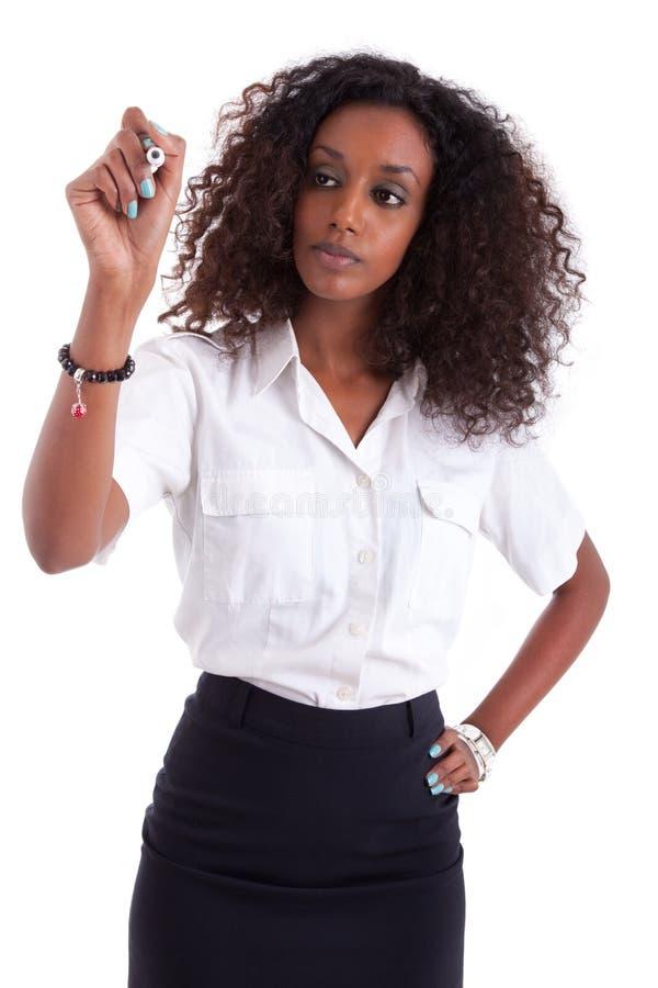 Het Afrikaanse Amerikaanse bedrijfsvrouw schrijven stock foto