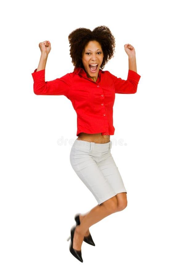 Het Afrikaanse Amerikaanse vrouw springen stock foto's