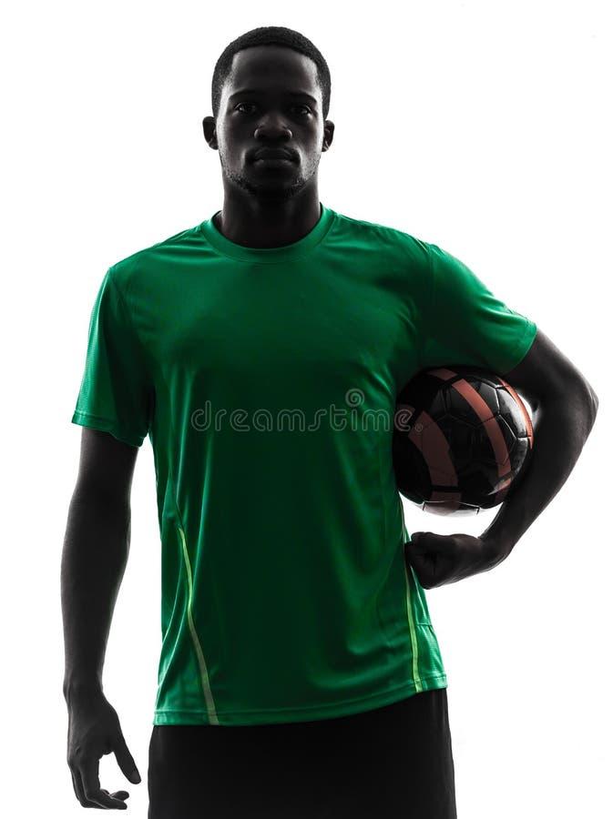 Het Afrikaanse silhouet van de de holdingsvoetbal van de mensenvoetballer royalty-vrije stock afbeeldingen