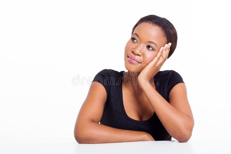 Het Afrikaanse vrouw denken stock foto's