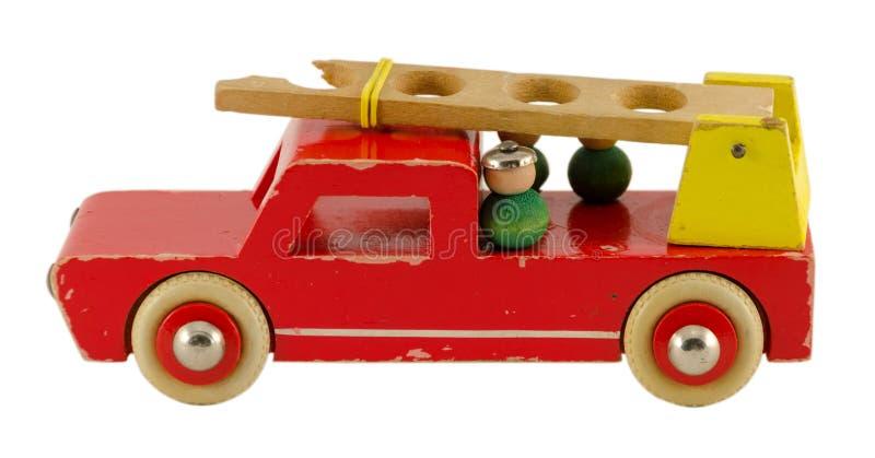 Het antieke houten brandweerautostuk speelgoed isoalted op wit royalty-vrije stock fotografie