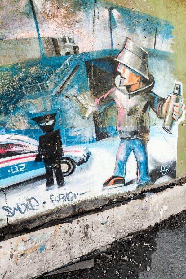 Het art Graffitifragment op oude concrete muur royalty-vrije stock afbeeldingen