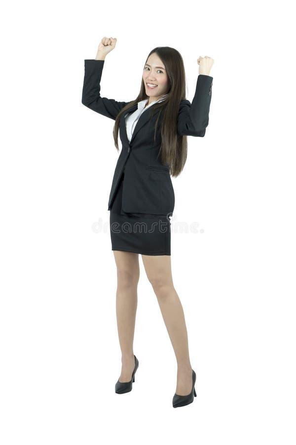Het Aziatische bedrijfsvrouw vieren vrolijk voor haar succes Volledig lichaam dat op witte achtergrond wordt geïsoleerdi stock foto's