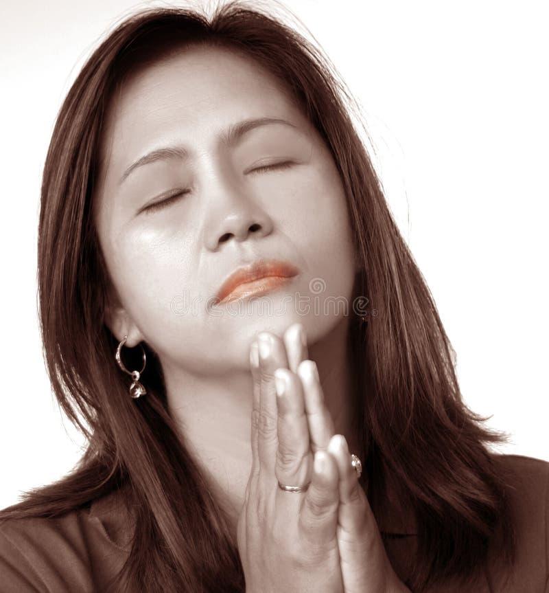 Het Aziatische bidden stock afbeeldingen