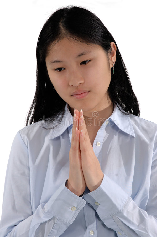 Het Aziatische Bidden van het Meisje stock foto