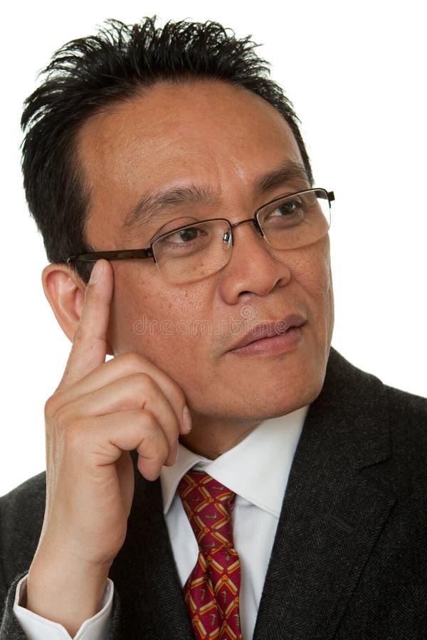 Het Aziatische de zakenman van het portret denken royalty-vrije stock foto