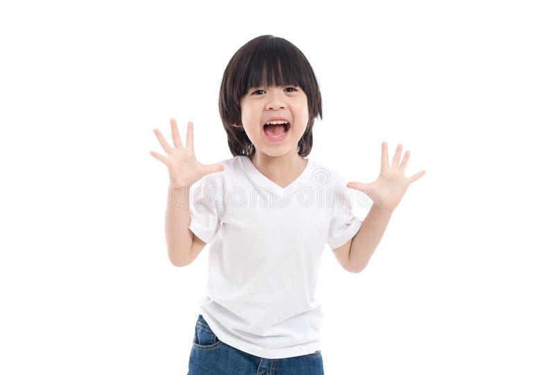Het Aziatische kind is verrast en zo gelukkig over het royalty-vrije stock afbeeldingen