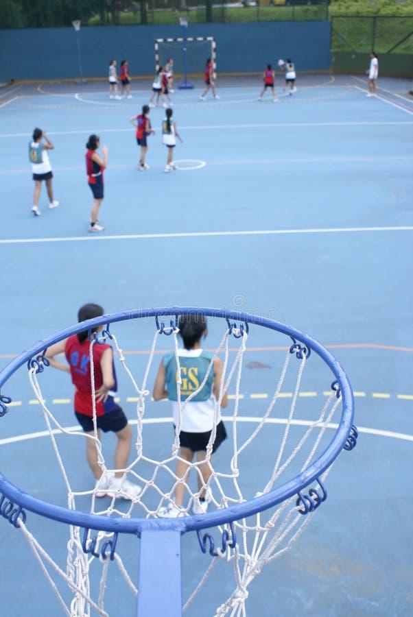 Het Aziatische spel van het tienernetball royalty-vrije stock afbeeldingen