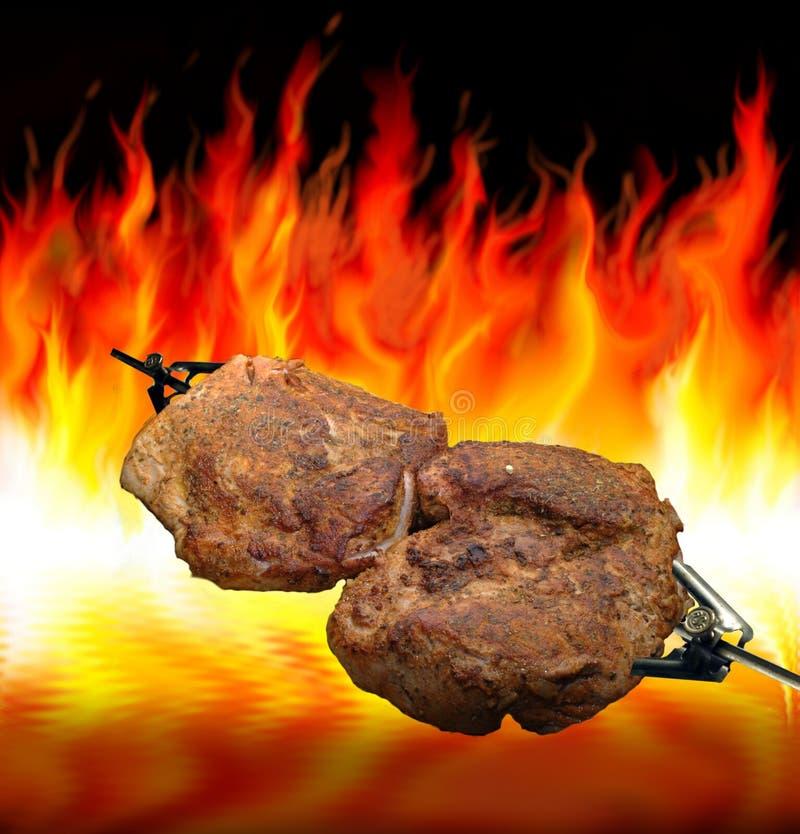 Het bakken bij de grill stock afbeelding