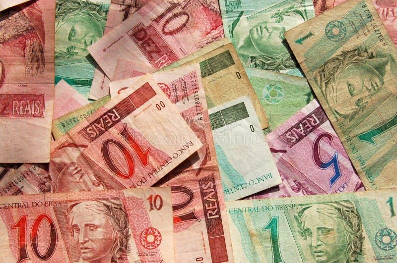Het bankbiljetachtergrond van Brazilië stock afbeeldingen