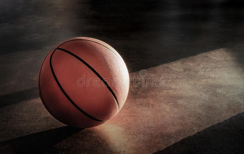 Het basketbal legt op de vloer stock fotografie
