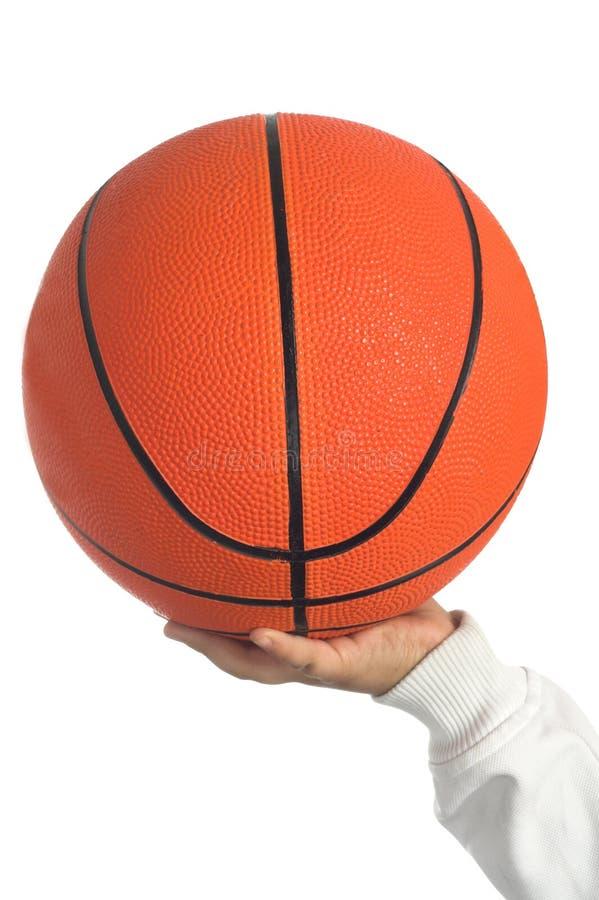 Het basketbal van de holding royalty-vrije stock afbeelding