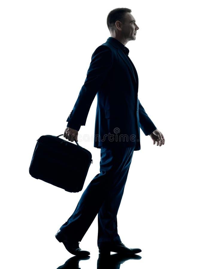 Het bedrijfsmens lopen geïsoleerd silhouet royalty-vrije stock afbeelding