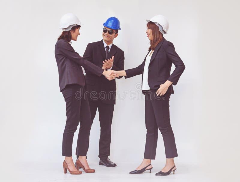 Het bedrijfsvoorman schudden handen, die omhoog een vergadering beëindigen stock foto's