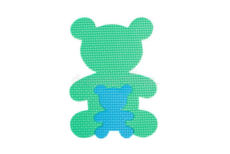 Het beeld van stuk speelgoed draagt en een teddybeer, geïsoleerde, witte achtergrond stock afbeeldingen