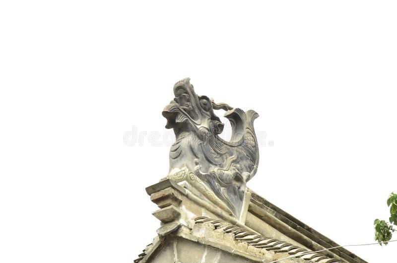 Het beeldhouwwerk in oude architectuur naast het dramastadium in Xuzhou, China stock afbeeldingen