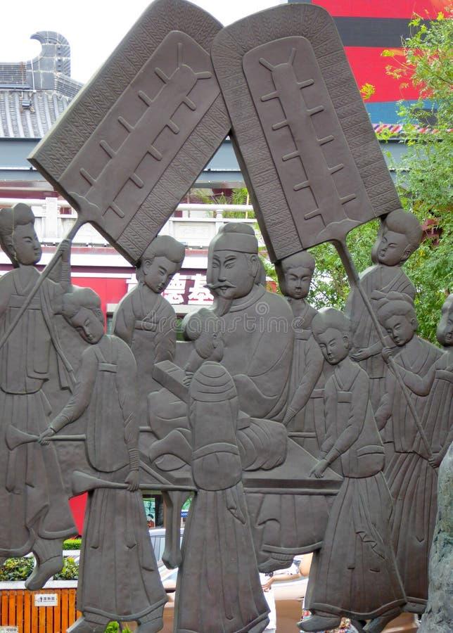 Het beeldhouwwerk van het stadscijfer stock foto