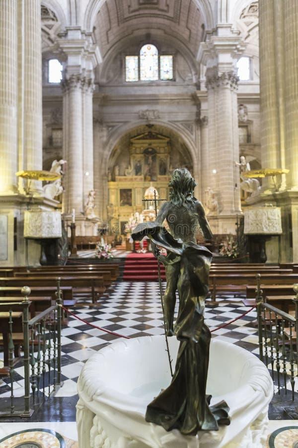Het beeldhouwwerk van toegenomen Jesus maakte in brons stock foto