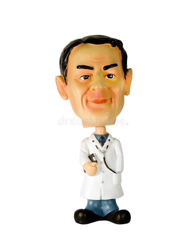 Het beeldje van de arts dat met het knippen van weg wordt geïsoleerdr stock afbeeldingen
