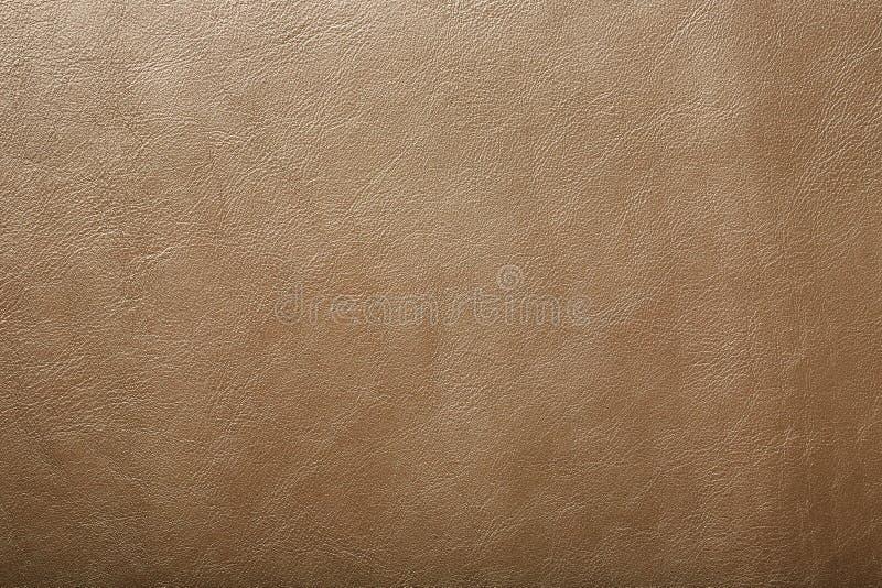 Het beige van de leertextuur als abstracte achtergrond, het mooie Volledige scherm van de patroontextuur stock foto