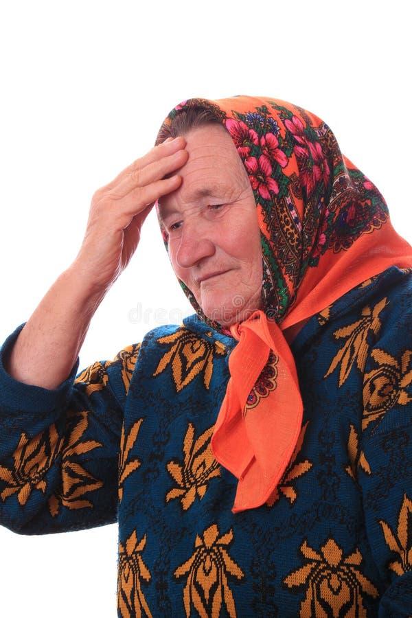 Het bejaarde die met de hand aan het hoofd raken royalty-vrije stock foto