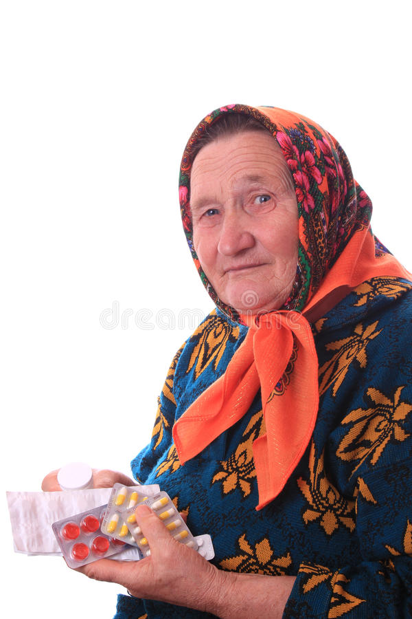 Het bejaarde met geneesmiddelen in handen royalty-vrije stock afbeelding