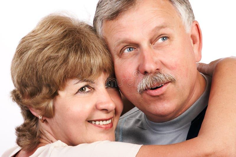 Het bejaarde paar glimlachen. stock foto's
