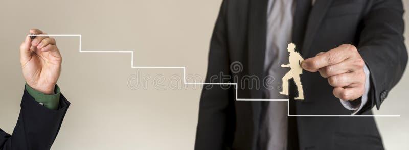 Het beklimmen van de collectieve ladder aan succes stock foto