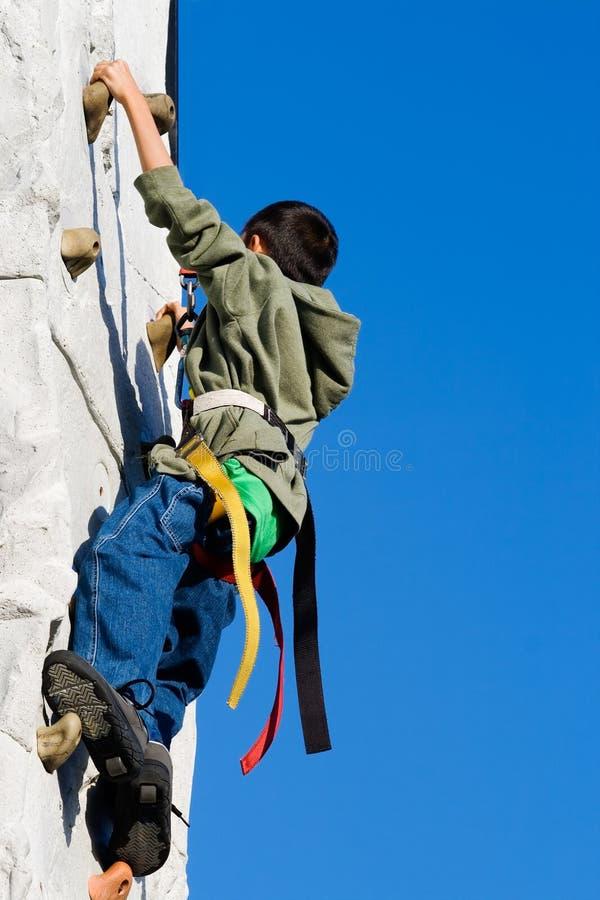 Het Beklimmen van de muur stock foto