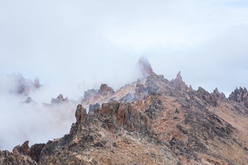 Het beklimmen van de Pieken stock foto