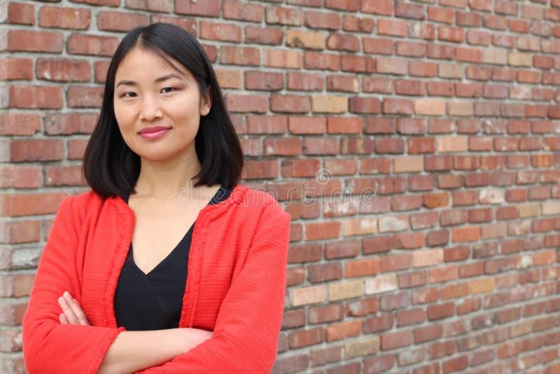 Het bepaalde kijken Aziatische werkende vrouw met exemplaarruimte stock foto's