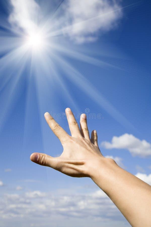 Het bereiken van de zon stock fotografie