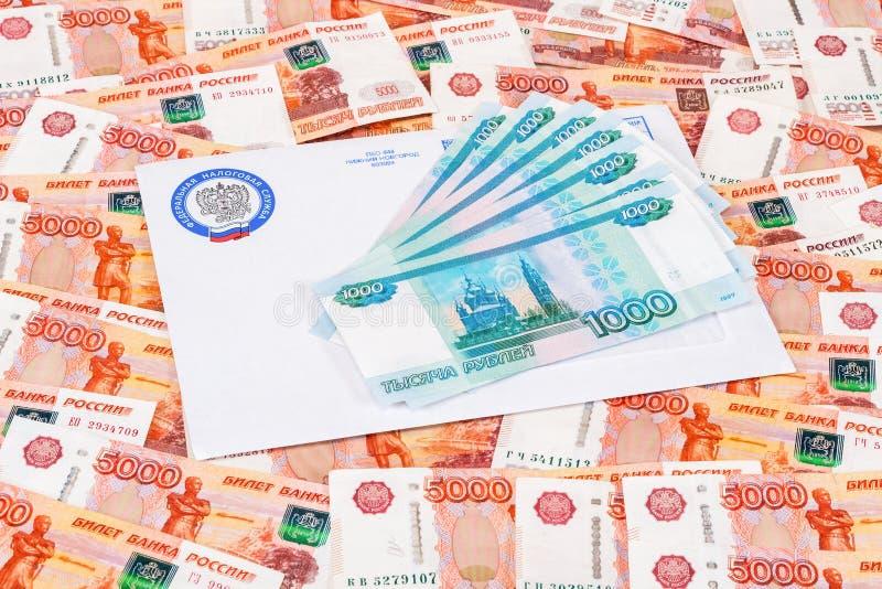 Het berichtbrief van de belastingsbetaling met embleem van de Federale Belastingsdienst o stock afbeelding