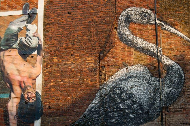 Het beroemde graffitiwerk aangaande de straten van Oost-Londen, Engeland stock fotografie