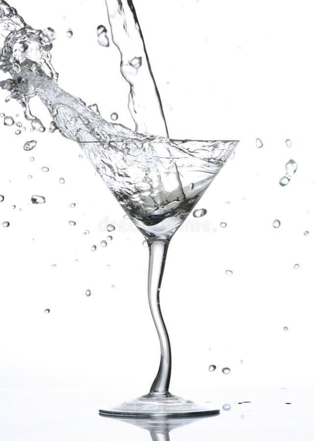 Het bespatten van het water in glas royalty-vrije stock afbeelding