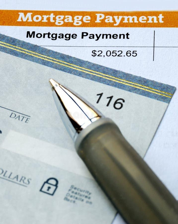 Het betalen van de hypotheek voor de primaire woonplaats stock foto's