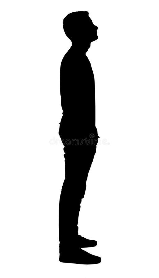 Het bevindende silhouet van de jongen stock foto